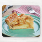 Slice of fresh baked apple pie on plate mouse mat
