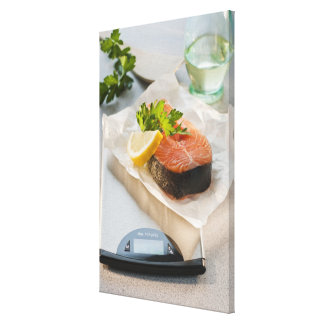 Slice of salmon on weight scale canvas print