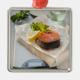 Slice of salmon on weight scale christmas ornament
