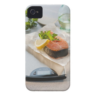 Slice of salmon on weight scale iPhone 4 cases