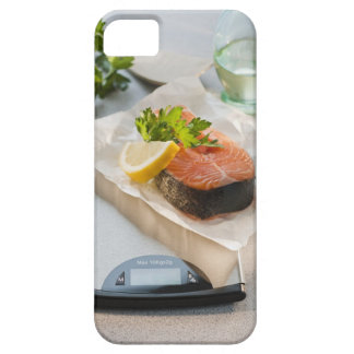 Slice of salmon on weight scale iPhone 5 cover