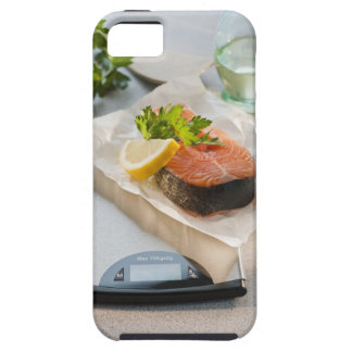 Slice of salmon on weight scale iPhone 5 covers