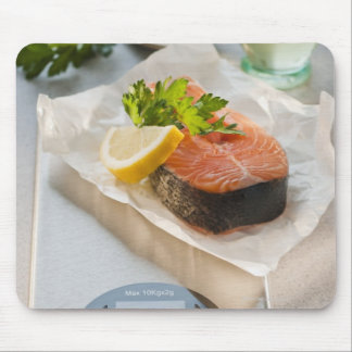 Slice of salmon on weight scale mouse mat
