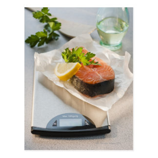 Slice of salmon on weight scale postcard
