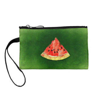 Slice of watermelon on green background coin wallet