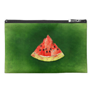 Slice of watermelon on green background travel accessory bags