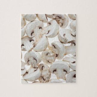 Sliced button mushrooms (agaricus bisporus), on jigsaw puzzle