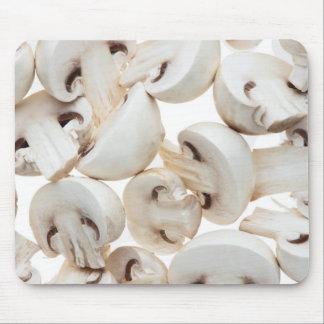 Sliced button mushrooms (agaricus bisporus), on mouse mat
