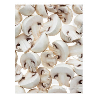 Sliced button mushrooms (agaricus bisporus), on postcard
