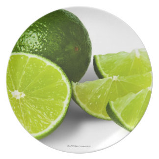 Sliced lime wedge, on white background, cut out plate