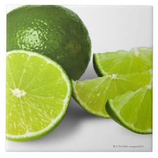 Sliced lime wedge, on white background, cut out tile