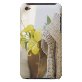 Slippers beside a wooden bowl with yellow lilies iPod Case-Mate cases