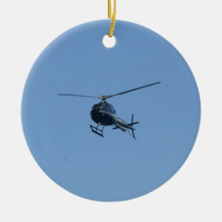 Small black helicopter. round ceramic decoration