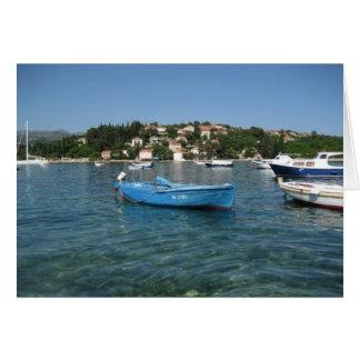 Small boat in sea off Kolocep, Croatia Card