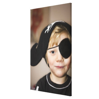 Small boy dressed as pirate canvas print