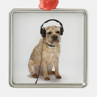 Small dog wearing headphones christmas ornament