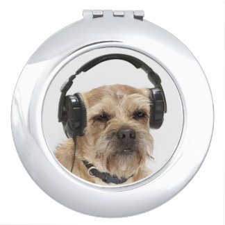 Small dog wearing headphones compact mirror
