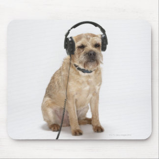 Small dog wearing headphones mouse mat
