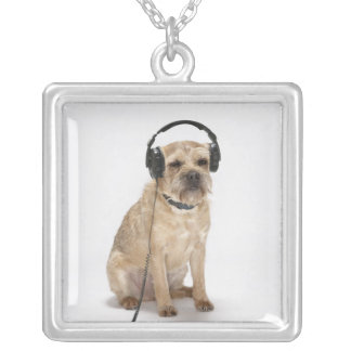 Small dog wearing headphones silver plated necklace