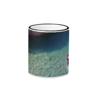 small floating  boat on the crystal clear cliff la ringer mug