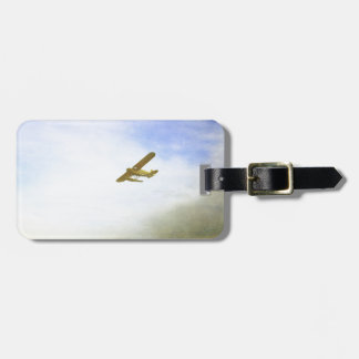 Small plane with blue sky luggage tag