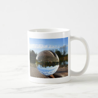 Small sea seen through a crystal ball basic white mug