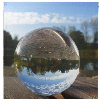 Small sea seen through a crystal ball cloth napkin