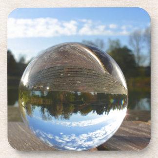Small sea seen through a crystal ball coasters