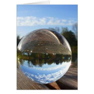 Small sea seen through a crystal ball greeting card