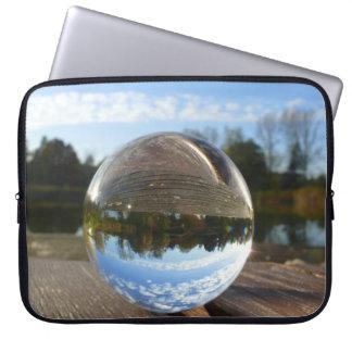 Small sea seen through a crystal ball laptop computer sleeve