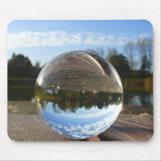 Small sea seen through a crystal ball mouse pad