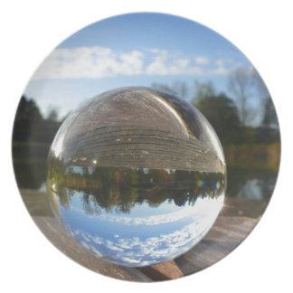 Small sea seen through a crystal ball plates