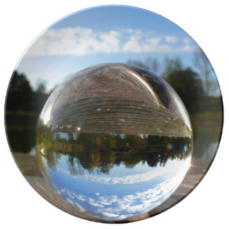 Small sea seen through a crystal ball porcelain plates