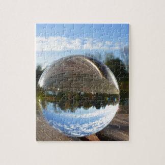 Small sea seen through a crystal ball jigsaw puzzle