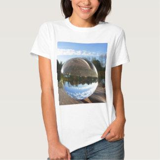 Small sea seen through a crystal ball tshirts