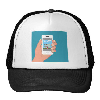 Smartphone in hand with house picture cap