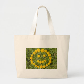 smile with dandelion on grass large tote bag