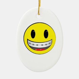 Smiley with braces ceramic oval decoration