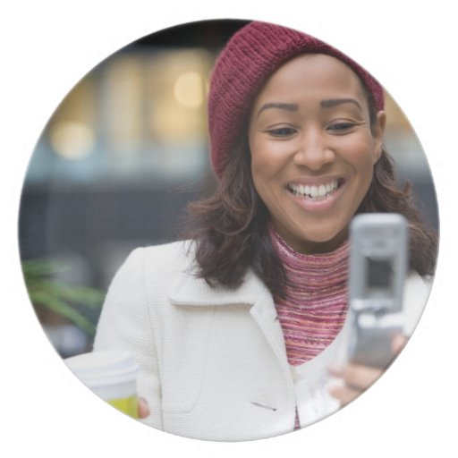 Smiling Business Woman with Cell Phone Plates