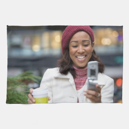Smiling Business Woman with Cell Phone Towels