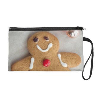 Smiling gingerbread man wristlet