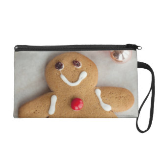 Smiling gingerbread man wristlet purse