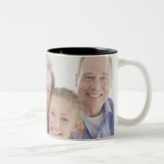 Smiling grandparents reading cookbook with Two-Tone coffee mug
