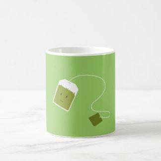 Smiling green tea bag mug