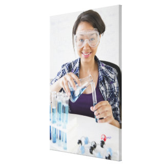 Smiling mixed race teenage girl conducting canvas print