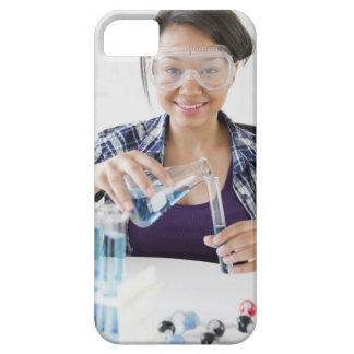 Smiling mixed race teenage girl conducting iPhone 5 cover