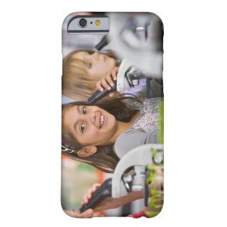 Smiling students peering into microscopes in barely there iPhone 6 case