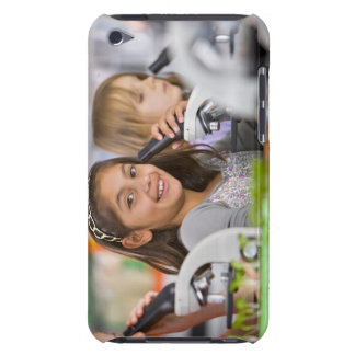 Smiling students peering into microscopes in iPod Case-Mate cases