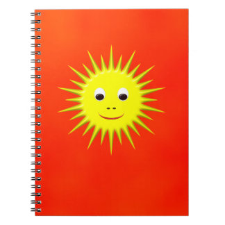 Smiling Sun with orange sky notebook