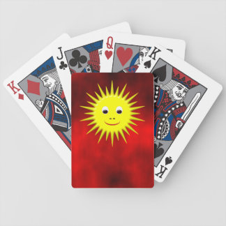 Smiling Sun with red sky playing cards